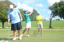 Trey Whitnell, junior, Jay Taylor, freshman, and Hunter Travis, sophomore, prepare for the 2014 golf season Sept. 3, 2014. | Photo by Meg Rushing